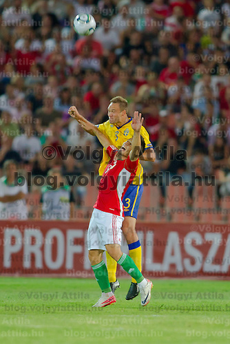 Hungary's Imre Szabics (front) fights for the ball with Sweden's Andreas Granqvist (back) during the UEFA EURO 2012 Group E qualifier Hungary playing against Sweden in Budapest, Hungary on September 02, 2011. ATTILA VOLGYI