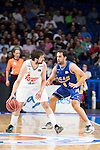 Real Madrid's Sergio Llull and UCAM Murcia's Benite during the first match of the playoff at Barclaycard Center in Madrid. May 27, 2016. (ALTERPHOTOS/BorjaB.Hojas)