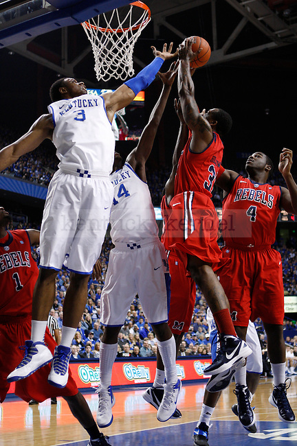 Players go for a rebound ball during the first half of the game against the University of Mississippi in Lexington, Ky., on Saturday, Feb. 18, 2012. Photo by Tessa Lighty | Staff