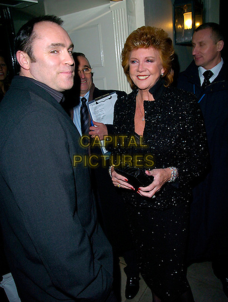 CILLA BLACK.Sharon Osbourne's Christmas Party, 30 Pavillion Road, London, UK..December 19th, 2006.full length black skirt jacket sequins sequined clutch purse.CAP/CAN.©Can Nguyen/Capital Pictures