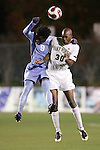 16 November 2007: North Carolina's Eddie Ababio (9) and Wake Forest's Lyle Adams (30) challenge for a header. Wake Forest University played the University of North Carolinaat SAS Stadium in Cary, NC in an Atlantic Coast Conference Men's Soccer tournament semifinal.