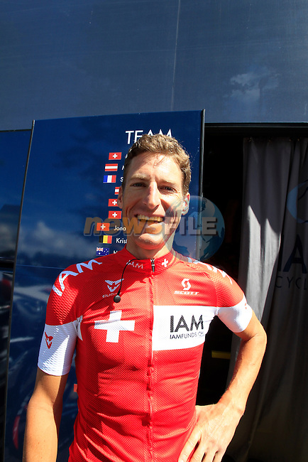 Swiss National Champion Martin Elmiger IAM Cycling at the team bus in Cambridge before the start of Stage 3 of the 2014 Tour de France running 155km from Cambridge to London. 7th July 2014.<br /> Picture: Eoin Clarke www.newsfile.ie