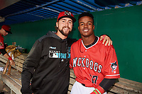 Batavia Muckdogs Harrison DiNicola and Dalvy Rosario in the dugout for a rain delay during a NY-Penn League game against the Auburn Doubledays on June 15, 2019 at Dwyer Stadium in Batavia, New York.  Batavia defeated Auburn 7-5.  (Mike Janes/Four Seam Images)