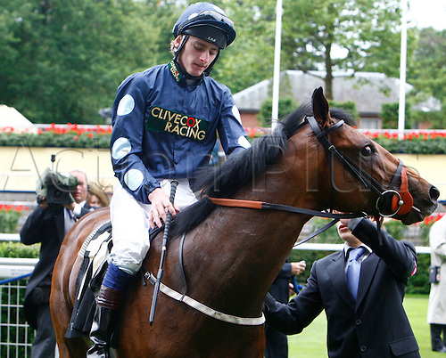21.06.12 Ascot, Windsor, ENGLAND: .Adam Kirby riding  on Reckless Abandon coming to the winning post.The Norfolk Stakes.during Ladies Day Royal Ascot Festival at Ascot racecourse on June 21, 2012 in Ascot, England.....