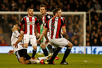 Aleksandar Mitrovic of Fulham FC is fouled during the Sky Bet Championship match between Fulham and Sheff United at Craven Cottage, London, England on 6 March 2018. Photo by Carlton Myrie.