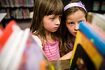 Bea, left, and Vivian  Ferrell look for books at a library in Auburn, CA  May 13, 2009.