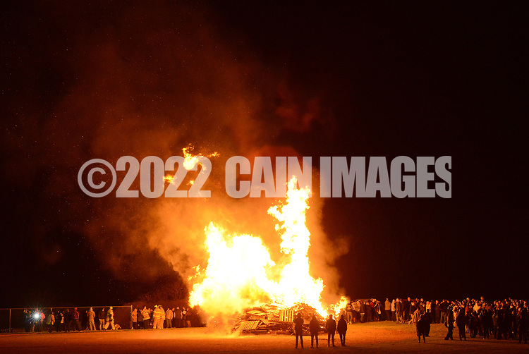 Participants stand around the bonfire during a pep rally to cheer on the Palisades High School football team Thursday, November 16, 2017 at Palisades Middle School in Kintnersville. Palisades, 11-0 this season, will be playing Lehighton on Saturday for the PIAA District 11 Class 3A title at Bethlehem School District Stadium. (Photo by William Thomas Cain)