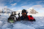 Film maker Stuart Ireland, member of the Elysium Expedition Film team, in Brash Ice near Danco Island, Antarctic Peninsula