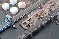 "Eastbound Approach & Bridge Foundation Construction Contract B1, Pearl Harbor Memorial ""Q"" Bridge, just east of Interstate I-95 I-91 CT Route 34 Interchanges. Forbes Avenue and Tomlinson Bridge at left. Details of approaches, overpasses, ramps & roadway near or within I-95 New Haven Harbor Crossing Corridor projects confines. Photography taken at the beginning of Contract B1"