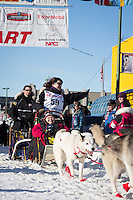 Karen Ramstead and team leave the ceremonial start line at 4th Avenue and D street in downtown Anchorage during the 2014 Iditarod race.<br /> Photo by Jim R. Kohl/IditarodPhotos.com