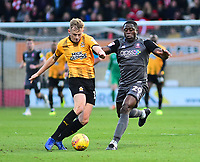 Lincoln City's John Akinde vies for possession with  Cambridge United's Harry Darling<br /> <br /> Photographer Andrew Vaughan/CameraSport<br /> <br /> The EFL Sky Bet League Two - Cambridge United v Lincoln City - Saturday 29th December 2018  - Abbey Stadium - Cambridge<br /> <br /> World Copyright © 2018 CameraSport. All rights reserved. 43 Linden Ave. Countesthorpe. Leicester. England. LE8 5PG - Tel: +44 (0) 116 277 4147 - admin@camerasport.com - www.camerasport.com