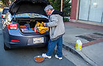 A local volunteer for H.A.R.P. (Homeless Animal Response Program), of Antioch, prepares to set out food for cats in Antioch, California, on Friday, March 21, 2014.  Photo/Victoria Sheridan