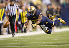 Sept 13, 2014; Wide receiver C.J. Prosise dives for the ball  against Purdue in the Shamrock Series football game at Lucas Oil Stadium in Indianapolis. (Photo by Barbara Johnston/University of Notre Dame)