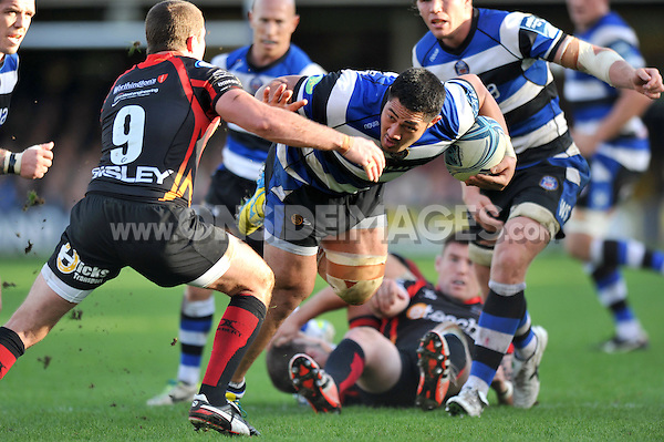 Alafoti Fa'osiliva looks to fend Richie Rees. Amlin Challenge Cup match, between Bath Rugby and the Newport Gwent Dragons on October 19, 2013 at the Recreation Ground in Bath, England. Photo by: Patrick Khachfe / Onside Images
