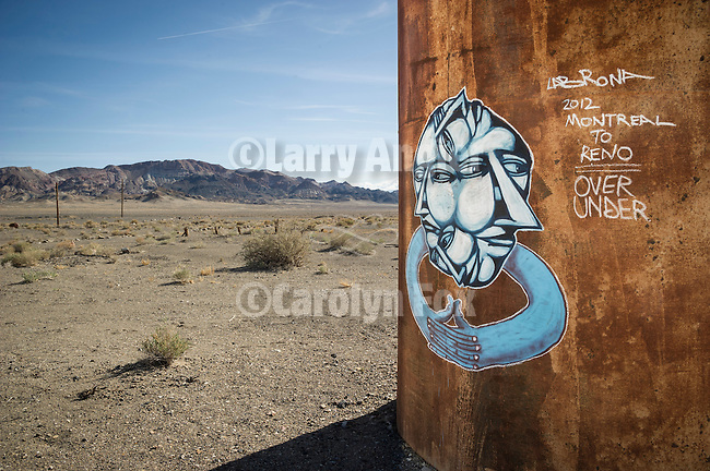 Abandoned roadhouse and gas station at the U.S. Highways 6 and 95 Junction, Coaldal, Nevada<br /> <br /> Rusty tank with face collage painting