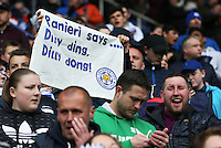 A Leicester fan holds up a banner with a Claudio Ranieri quote on during the Barclays Premier League match between Leicester City and Swansea City played at The King Power Stadium, Leicester on April 24th 2016
