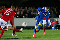 Joe Piggott of AFC Wimbledon shoots on goal during the Sky Bet League 1 match between AFC Wimbledon and Charlton Athletic at the Cherry Red Records Stadium, Kingston, England on 10 April 2018. Photo by Carlton Myrie / PRiME Media Images.