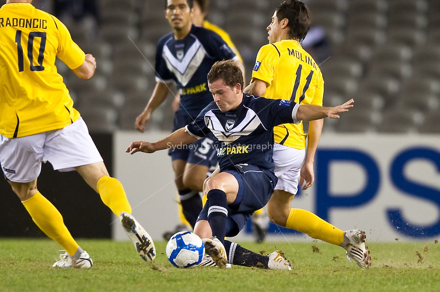 MELBOURNE, AUSTRALIA - MARCH 09, 2010: Leigh Broxham of Melbourne Victory controls the ball during the AFC Champions League Group E match between the Melbourne Victory and Seongnam Ilhwa Chunma at Etihad Stadium on March 9, 2010 in Melbourne, Australia. Photo Sydney Low www.syd-low.com