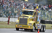 TOCANCIPÁ -COLOMBIA. 14-07-2013. 26° Gran Premio Nacional De Tractomulas realizado hoy en el autodromo de Tocancipá, Colombia. En la imagen el conductor # 78 Libardo Guerrero./ 26th National Trucks Grand Prix at Tocancipa racetrack today in Tocancipa, Colombia. In the image the number 78 pilot Libardo Guerrero in his classification step. Photo: VizzorImage / Str