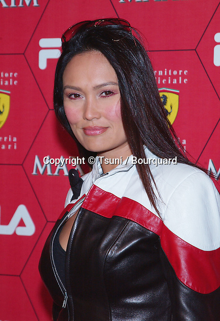 Tia Carrere arriving at the Seduction Of Speed an evening with the magazine Maxim at the Lounge @ Astra in Los Angeles. March 14, 2002.