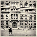 Person taking a photograph of the Adams Courthouse in Boston