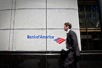 A man walks by the a Bank of America logo in Toronto financial district April 22, 2010. Bank of America Corporation (NYSE: BAC) is a financial services company, the largest bank holding company in the United States, by assets, and the second largest bank by market capitalization.
