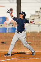 Oswaldo Arcia #24 of the Elizabethton Twins follows through on his swing against the Johnson City Cardinals at Howard Johnson Field July 3, 2010, in Johnson City, Tennessee.  Photo by Brian Westerholt / Four Seam Images