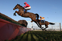 Rockandahardplace ridden by Mr G Barfoot-Saunt in jumping action during the Weatherbys Cheltenham Festival Betting Guide Novices Chase .