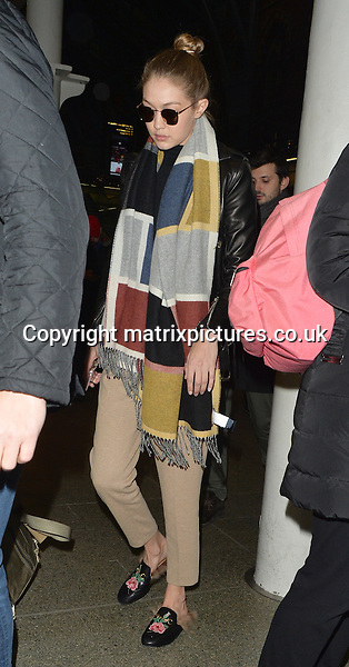 EXCLUSIVE ALL ROUND PICTURE: MATRIXPICTURES.CO.UK<br /> PLEASE CREDIT ALL USES<br /> <br /> ***DOUBLE SPACE RATES APPLY***<br /> <br /> WORLD RIGHTS<br /> <br /> American supermodel Gigi Hadid arrives at London's Kings Cross St. Pancras station following a trip on the Eurostar from Brussels. <br /> <br /> The 21-year-old beauty cuts a low key figure in a black leather jacket and sunglasses as she arrives in London ahead of an appearance at the British Fashion Awards.<br /> <br /> DECEMBER 4th 2016<br /> <br /> REF: LTN 163721