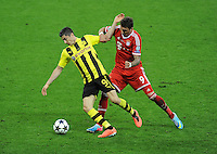 25.05.2013 London, England. Robert Lewandowski, Borussia Dortmund, and Mario Mandzukic, Bayern Munich, in action in the 2013 UEFA Champions League Final between Bayern Munich and Borussia Dortmund from Wembley Stadium. Picture Credit: Tommy Grealy/actionshots.ie