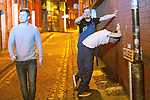 © Joel Goodman - 07973 332324 . 27/12/2016 . Wigan , UK . A man vomits against a wall on a side street . Revellers in Wigan enjoy Boxing Day drinks and clubbing in Wigan Wallgate . In recent years a tradition has been established in which people go out wearing fancy-dress costumes on Boxing Day night . Photo credit : Joel Goodman