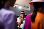 Brazilian fashion designer Dudu Bertholini, of Neon, anxiously checks out his garnets on models backstage at São Paulo Fashion Week for Summer Season 2013/2014, at Bienal, in São Paulo, Brazil, on Wednesday, March 20, 2013.