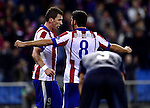 Manduzick and Raul Garcia celebrates goal during the UEFA Champions League semifinal first leg football match Club Atletico de Madrid vs Chelsea FC at the Vicente Calderon stadium in Madrid on November 26, 2014.   PHOTOCALL3000/ DP