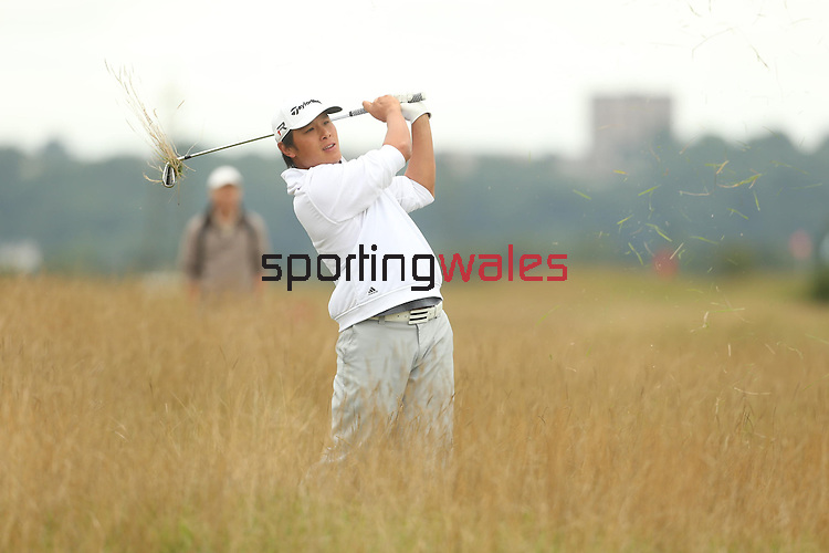 Zhiqun Lam plays from the deep rough on the 2nd hole during the second round of the ISPS Handa Wales Open 2013 at the <br /> Celtic Manor Resort<br /> <br /> <br /> 30.08.13<br /> <br /> ©Steve Pope-Sportingwales