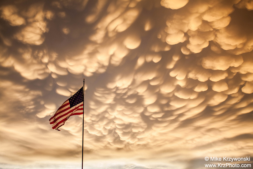 Golden Mammatus Clouds at Sunset above the U.S. Flag  in Dodge City, KS, May 24, 2016