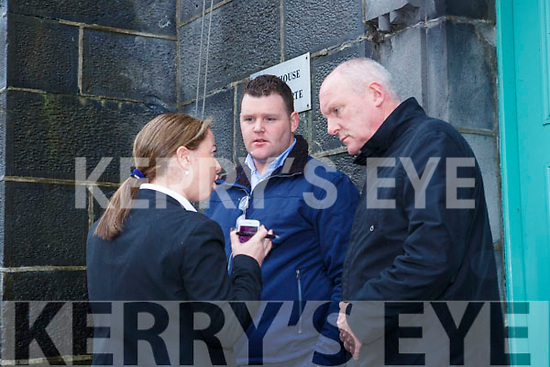 John Refan talking to his solicitors Eimear Griffin and Padraig