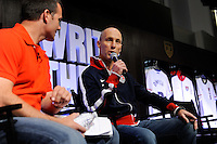 USA National Team Head Coach Bob Bradley talks with Eric Wynalda during the unveiling of the USA Men's National Team new uniform at Niketown in NYC, NY, on April 29, 2010.
