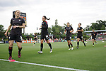 18 May 2011: U.S. players during pregame warmups. From left: Rachel Buehler, Stephanie Cox, Tobin Heath, Lauren Cheney, and Carli Lloyd. The United States Women's National Team defeated the Japan Women's National Team 2-0 at WakeMed Stadium in Cary, North Carolina as part of preparations for the 2011 Women's World Cup.