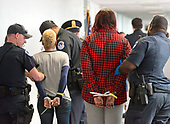 Unidentified demonstrators are arrested by United States Capitol Police in the Hart Senate Office Building as she protests against the Republican bill to replace the Affordable Care Act (ACA), also known as Obamacare, in the United States Senate Office Buildings on Capitol Hill in Washington, DC on Wednesday, July 19, 2017. <br /> Credit: Ron Sachs / CNP<br /> (RESTRICTION: NO New York or New Jersey Newspapers or newspapers within a 75 mile radius of New York City)