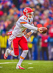 9 November 2014: Kansas City Chiefs quarterback Alex Smith makes a first quarter hand-off against the Buffalo Bills at Ralph Wilson Stadium in Orchard Park, NY. The Chiefs rallied with two fourth quarter touchdowns to defeat the Bills 17-13. Mandatory Credit: Ed Wolfstein Photo *** RAW (NEF) Image File Available ***