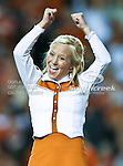 A Texas Longhorns cheerleader gets the crowd worked up before the game between the Oklahoma State Cowboys and the University of Texas in Austin Texas Longhorns at the Daryl K. Royal- Texas Memorial Stadium in Austin, Texas. The Oklahoma State Cowboys defeated the Texas Longhorns 33 to 16.