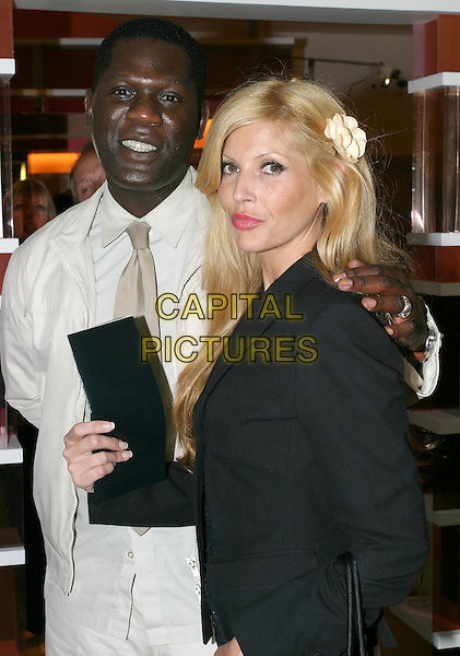 ERROL DOUGLAS & MANDY SMITH.Opening of Cobella Salon at Selfridges.June 3rd, 2004.Eroll, half length, half-length, flower, hair accessory.www.capitalpictures.com.sales@capitalpictures.com.© Capital Pictures.
