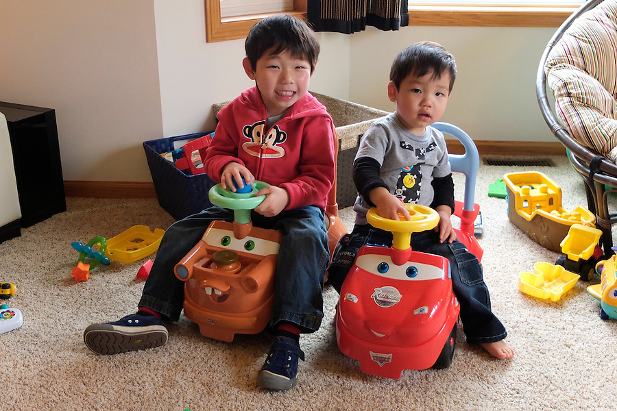 Holden Miller, 4, and Matthew Bucki, 20 months, meet for the first time at the Bucki family home in Eau Claire, Wis., on Nov. 27, 2011. Holden and Matthew are half-brothers and Korean adoptees, each born to the same birth mother and raised by the same foster mother.