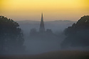 02/09/14 <br /> <br /> The spire of St. Peter's Church, Edensor, appears through a golden morning mist as dawn breaks over the Chatsworth estate in the Derbyshire Peak District.<br /> <br /> All Rights Reserved - F Stop Press.  www.fstoppress.com. Tel: +44 (0)1335 300098