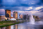 Dayton skyline with fountains, evening