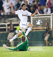 Real forward Gonzalo Higuain (20) attempts a shot on goal against Galaxy goalie Josh Saunders (12) during the second half of the friendly game between LA Galaxy and Real Madrid at the Rose Bowl in Pasadena, CA, on August 7, 2010. LA Galaxy 2, Real Madrid 3.