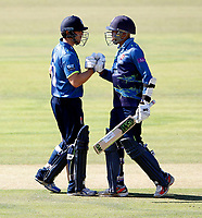 Daniel Bell-Drummond (R) congratulated on his fifty for Kent by Sean Dickson during the Royal London One Day Cup Final between Kent and Hampshire at Lords Cricket Ground, London, on June 30, 2018