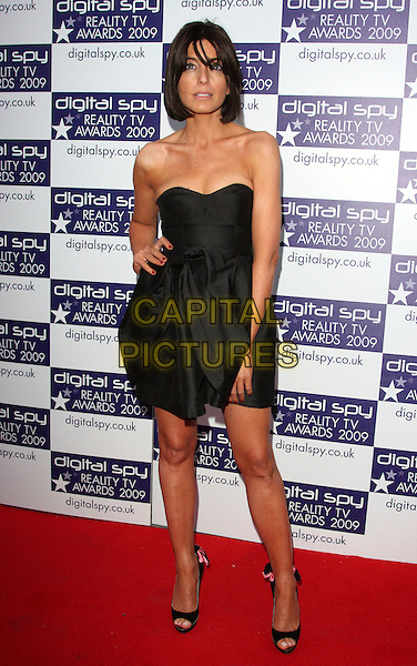 CLAUDIA WINKLEMAN.Digital Spy Reality TV Awards at the Bloomsbury Ballroom, London, England.  .April 6th, 2009.full length black strapless dress hand on hip open toe shoes .CAP/ROS.©Steve Ross/Capital Pictures.