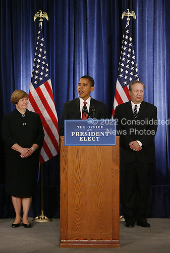 Chicago, IL - November 24, 2008 -- United States President-elect Barak Obama (C) introduces his economic team during a news conference on Monday, November 24, 2008 in Chicago. Obama named Council of Economic Advisers Chair-designate Christina Romer (L) and National Economic Council Director-designate Lawrence Summers (R) as well as Treasury Secretary-designate Timothy Geithner and White House Domestic Policy Council Director-designate Melody Barnes (not pictured). .Credit: Brian Kersey - Pool via CNP