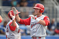 Williamsport Crosscutters first baseman Rhys Hoskins (12) is congratulated at the dugout after hitting a home run during a game against the Batavia Muckdogs on July 27, 2014 at Dwyer Stadium in Batavia, New York.  Batavia defeated Williamsport 6-5.  (Mike Janes/Four Seam Images)